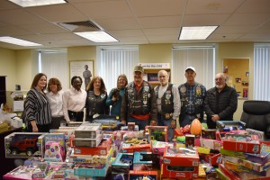 The Blue Knights with a small portion of the toys donated to CASA.