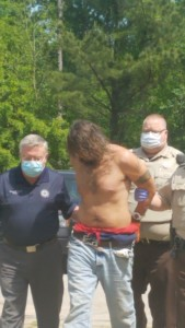 Troup County Sheriff James Woodruff escorts the murder suspect into the jail.